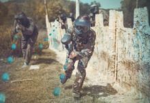 Woman Paintball Player In Full...