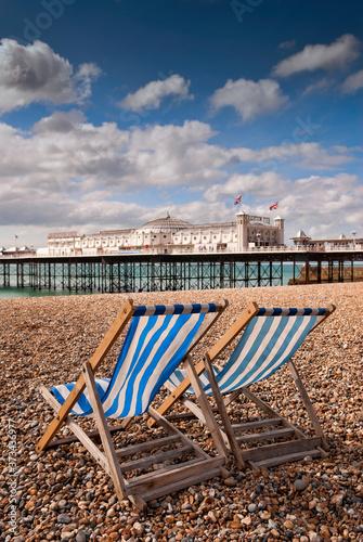 Brighton, England - September 11, 2009: Empty Deckchairs on Beach next to Bright Canvas Print