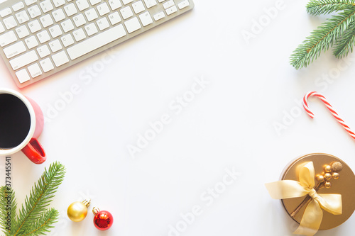 Fotografia, Obraz White Christmas, desk office with laptop, decoration and work supplies with cup of coffee