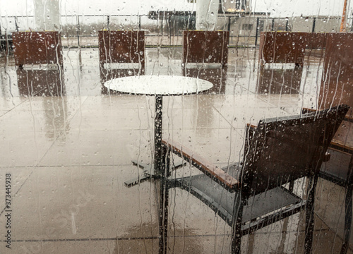 Deserted outdoor terrace on a rainy day Fototapeta