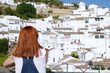 Woman looking to the white houses of Setenil de las Bodegas, Cadiz, , Andalusia, Spain.