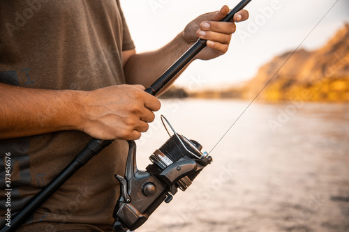 river fisherman with fishing rod Wallpaper Mural