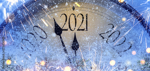 Countdown to midnight. Retro style clock counting last moments before Christmas or New Year 2021. © Sergey Peterman