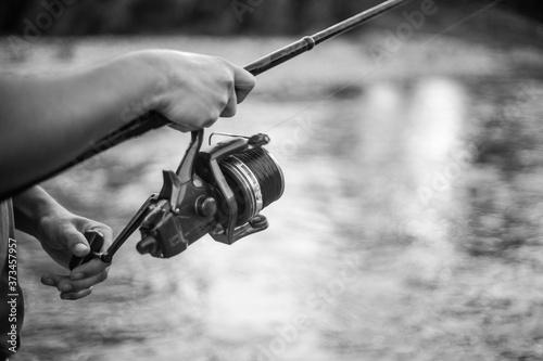 Fotografie, Obraz river fisherman with fishing rod