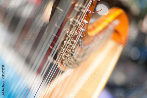 Photo Stringed musical instrument harp- close up view with focus concept