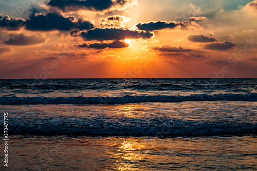 Fototapety, obrazy: Beautiful amazing sunset or sunrise over the sea or ocean. Rays of the sun through the clouds. Dramatic sky.