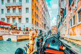 Fototapeta Uliczki - VENICE, ITALY - MAY 11, 2017 : Views of the most beautiful channels of Venice, narrow streets, from the board of the gondola.Italy.