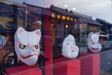 Japanese Old Style Fox And Okame Face Masks Are In Show Window In Kawagoe, Old Edo Town, Japan.