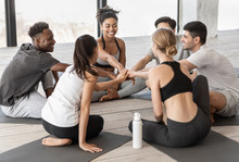 Teamwork And Unity. Diverse Yoga Class Friends Putting Hands Together After Training