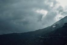 Castle On Hillside In Clouds