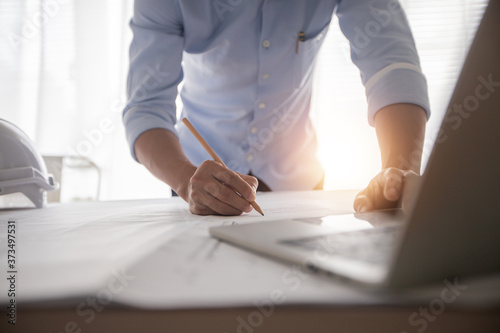 Architect working in office with blueprints,engineer thinking and planning inspection in workplace for architectural plan,sketching a construction project,Business construction concept Fototapete