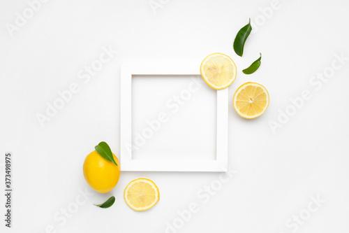 Obraz Elegant composition of set of lemons on a white background with white frame - fototapety do salonu