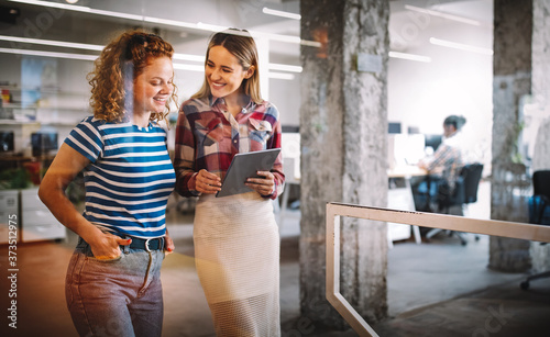 Fotografia Business people having fun and chatting at workplace office