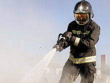 Firefighters Extinguishing A D...