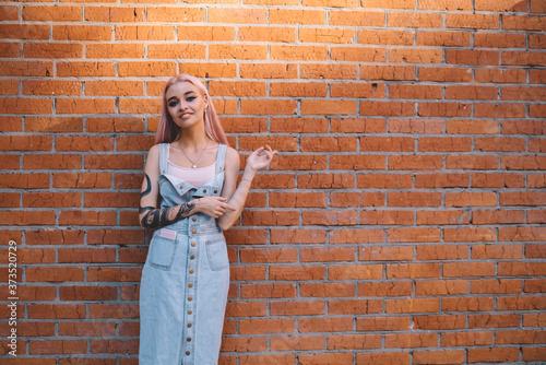 Fotografia, Obraz Half length portrait of trendy adolescent teenager dressed in casual jeans sundr