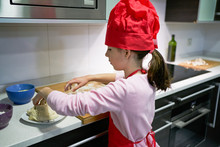 Girl With Red Chef's Hat Makes...