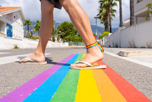 Rainbow Pedestrian Crossing With Boy Crossing The Street