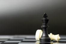 Black Chess King Piece Win Over White Queen For Business Winning Concept Over Competitors