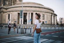 Serious Caucasian Female Traveler Pedestrian In Trendy Apparel In Hat Crossing Roads In Downtown, Young 20s Hipster Girl Strolling On Notable Locations And Destinations Spending Free Time Outdoors