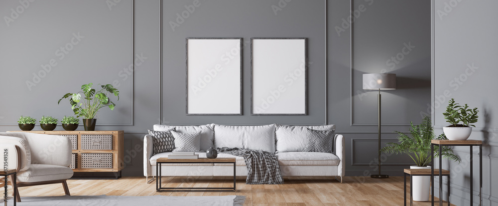 Fototapeta Frame mockup in living room interior , white sofa, armchair, lots of fresh plants and wooden coffee table, empty dark classic gray wall, panorama, 3d render