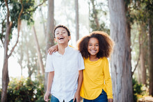 Portrait Of Laughing Brother And Sister In The Park