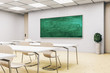Bright classroom interior with empty green blackboard