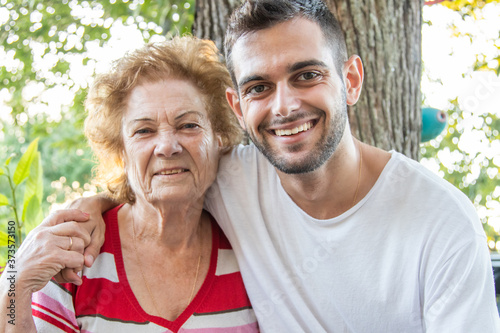 Cuadros en Lienzo portrait of young man with happy grandmother smiling outdoors