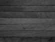 Background of black popsicle sticks with horizontal view.