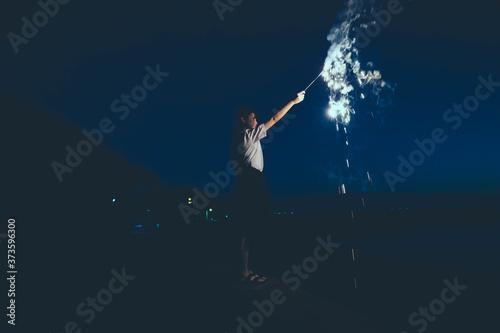 夜の海で花火をする女子高生 Canvas Print