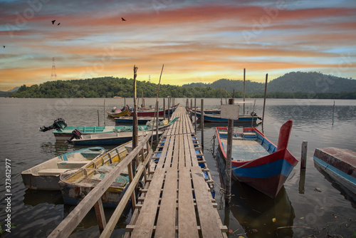 Fototapety, obrazy: beautiful sky at the wooden jetty.