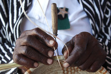 Motswana Old Woman Weaves A Reed Basket With Hands
