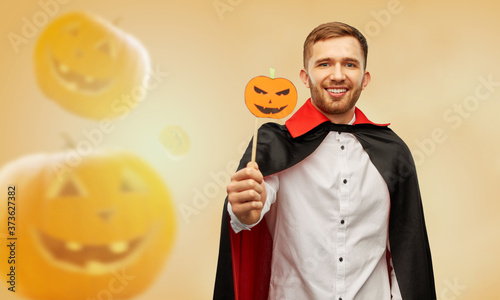 Fotografie, Obraz holiday, photo booth and people concept - happy smiling man in halloween costume