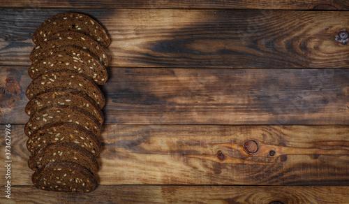 Fotografia Sliced fresh gluten-free bread on wooden surface