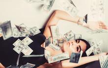 Sexy Woman Lying In Dollar Bil...