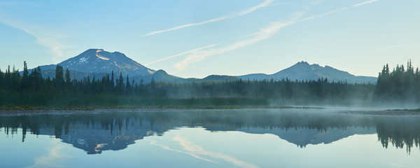 Fog over the Hosmer Lake in the morning with South Sister in central Oregon.