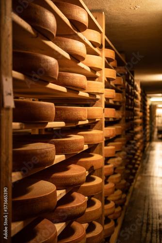 Fototapeta Gruyere cheese on shelves in L'Etivaz  obraz