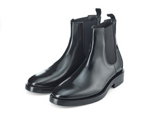 Autumn Chelsea Boots Made Of Thick Glossy Leather With A Low Heel, Isolated On A White Background With A Light Shadow. Top View At An Angle.