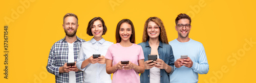 Cheerful young people with smartphones in hands Wallpaper Mural