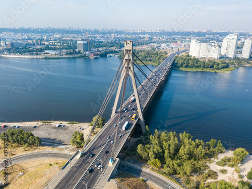 Aerial drone view. North bridge in Kiev and the Dnieper river on a clear summer morning. © Sergey