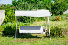 Garden. Garden Furniture Swing. Rest Area Near The House. Rest And Relaxation Concept.