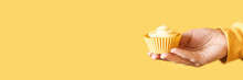 Yellow Monochrome Bakery. Sustainable Cupcake Cup. Hold In Hand. Gold Maffin Cream. Trendy Colourful Desert. Bright Birthday Gift. Horizontal Banner With Copyspace
