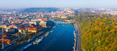 Leinwand Poster Picturesque view from drone of Prague on banks on Vltava river, capital and larg