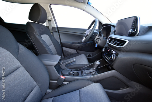 Obraz Modern car interior with seats and dashboard - fototapety do salonu