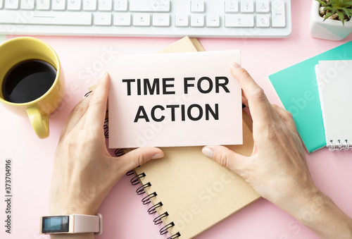 Photo business woman holding a notebook with the text Time for action