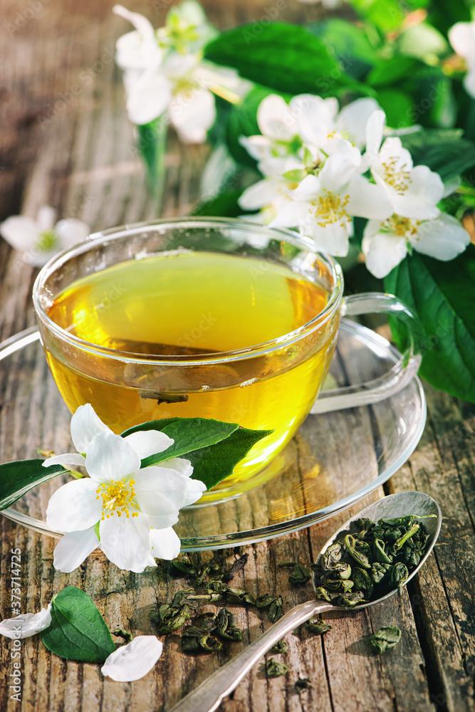 Fototapeta Cup of green tea with jasmine