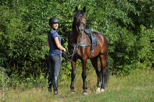 Fotografie, Tablou Tourist rider with saddle horse walking in outdoors