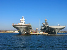 Two Aircraft Carriers Parked Next To Each Other And Being Repaired And Readied In San Diego Bay Where The US Navy Naval Base Is Located.