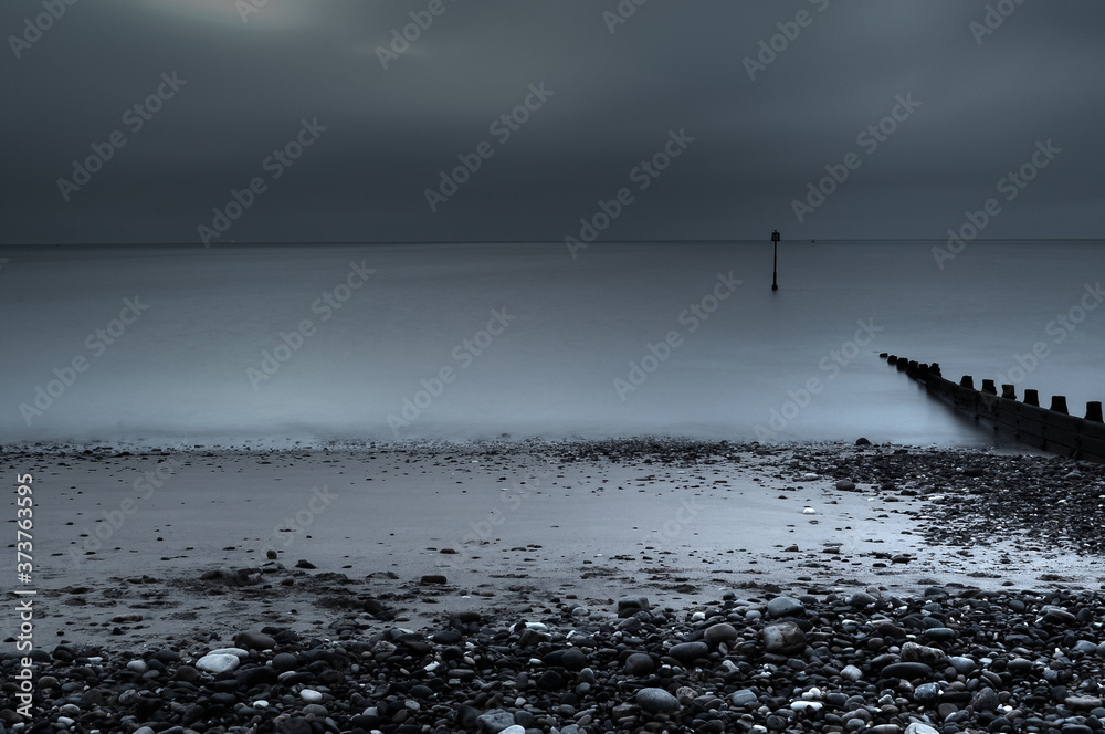 Fototapeta Landscape of the sea with long exposure under a stormy sky - perfect for wallpapers