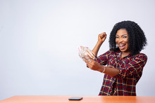 Beautiful Black Lady Holding Some Cash Feeling Excited And Happy