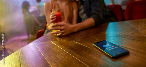 Cropped shot of unfaithful man spending time with another woman flirting in the bar, enjoying drinks and conversation Canvas Print